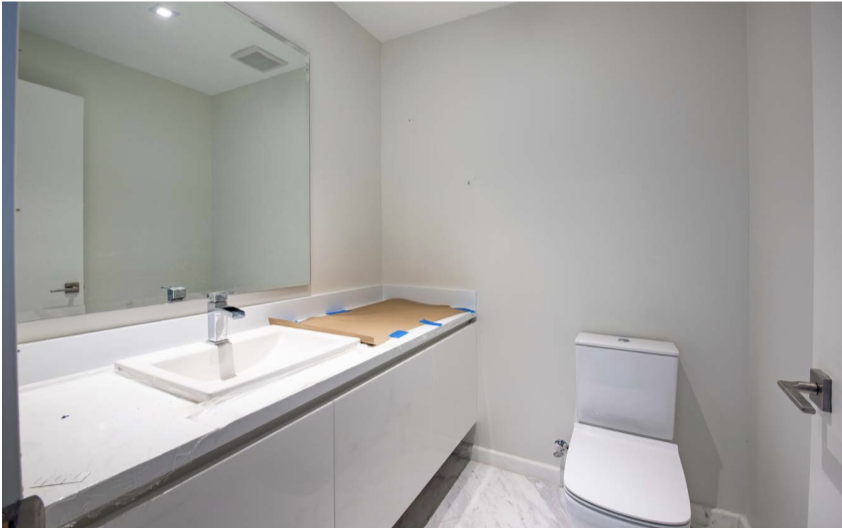 Before Bathroom | Paramount Residences Fort Lauderdale Rebuild and Redecoration by Kevin Gray Design