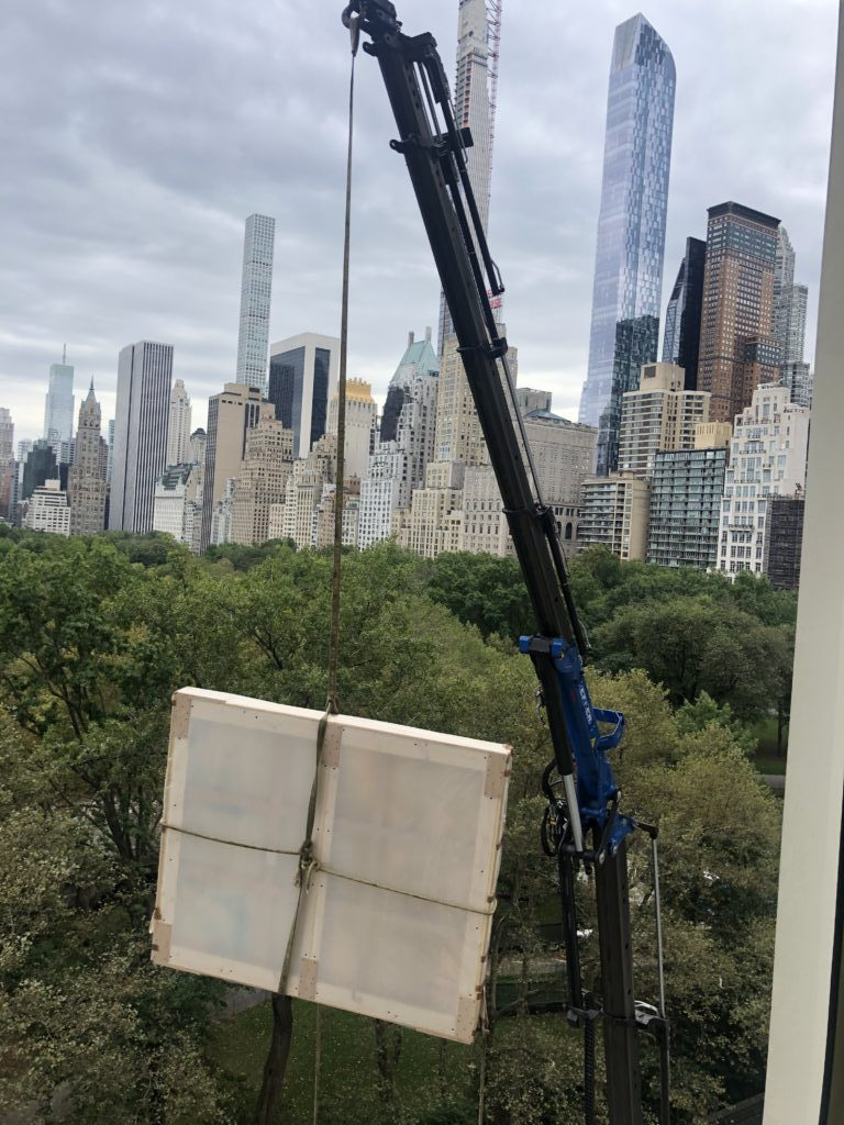 crane installing NYC large scale art